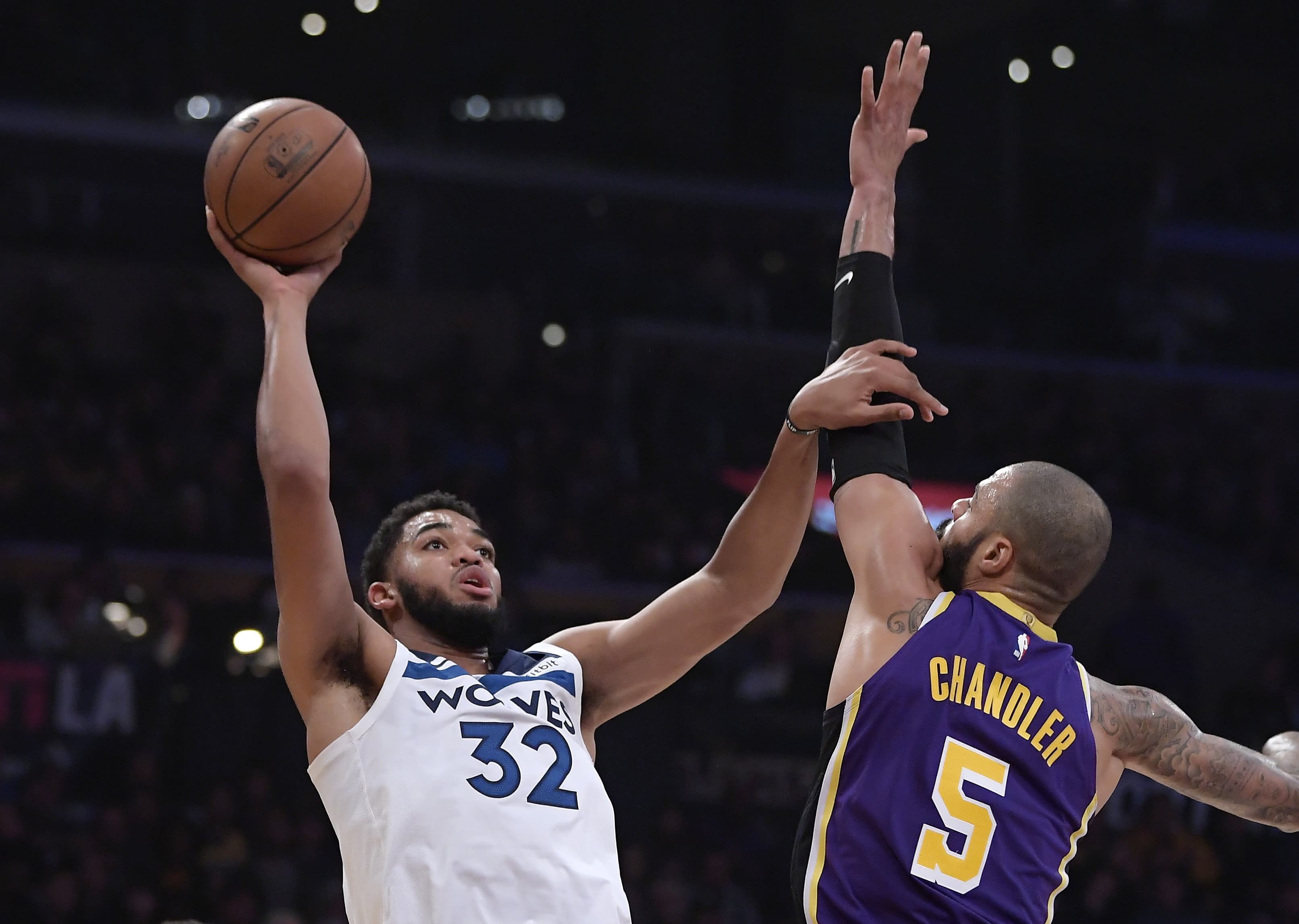 Minnesota Timberwolves center Karl-Anthony Towns, left, shoots as Los Angeles Lakers center Tyson Chandler defends during the first half of an NBA basketball game Wednesday, Nov. 7, 2018, in Los Angeles. (AP Photo/Mark J. Terrill)