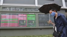 Asian shares mixed after US rally, positive data