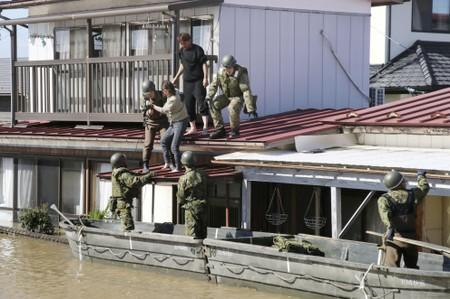 Local residents are rescued by Japapnese Defence-Force soldiers from a flooded area caused by Typhoon Hagibis in Kakuda