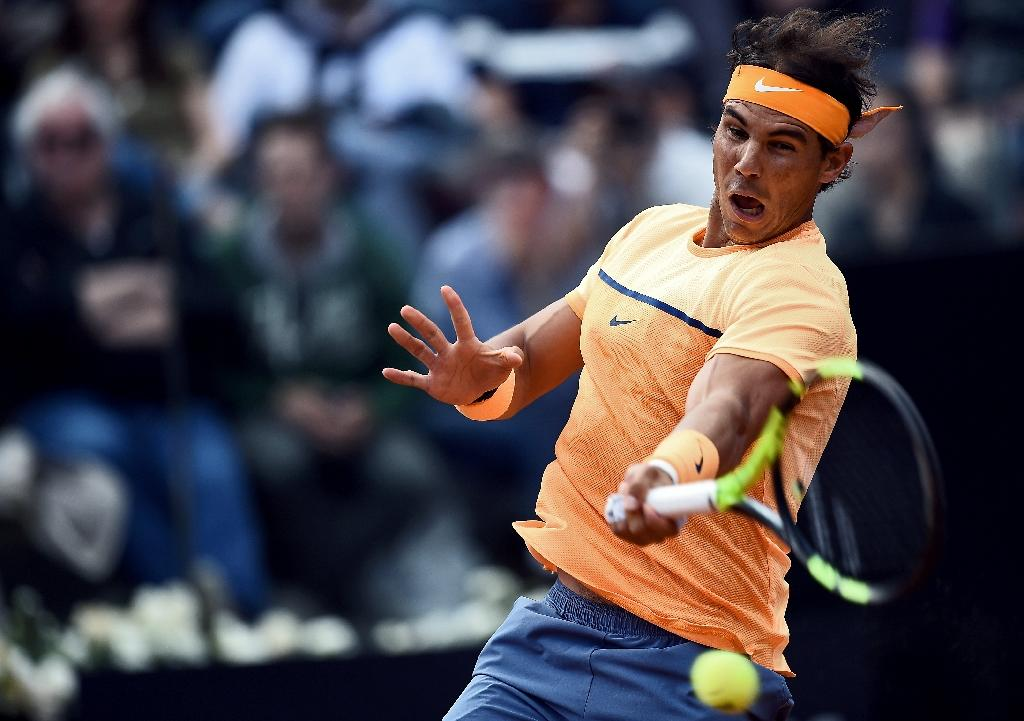 Rafael Nadal of Spain returns the ball to Australia's Nick Kyrgios during the ATP Tennis Open tournament at the Foro Italico in Rome on May 12, 2016 (AFP Photo/Filippo Monteforte)