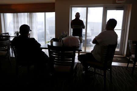 People watch Hurricane Michael from a hotel window in Panama City Beach, Florida, U.S., October 10, 2018. REUTERS/Jonathan Bachman