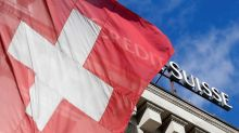 Activists in dinghy urge Credit Suisse off climate 'collision course'