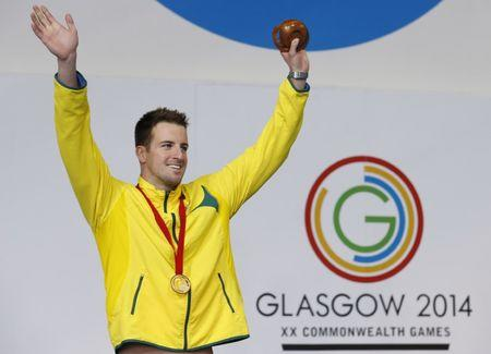 Australia's James Magnussen celebrates after winning the gold medal in men's 100m Freestyle final at the 2014 Commonwealth Games in Glasgow, Scotland