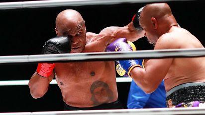 Tyson and Jones draw in entertaining fight