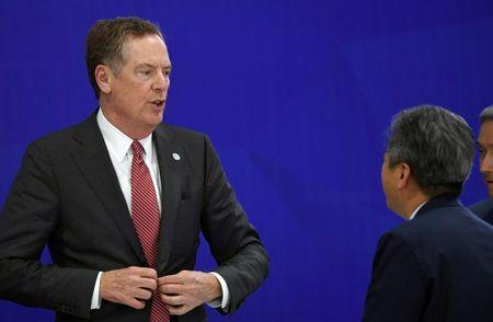 US Trade Representative Robert Lighthizer speaks with a delegate from South Korea's delegation at the end of a joint press conference in Hanoi