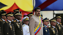 'Officer coups are often unsuccessful and bloody': Wall Street weighs in on a military coup taking out Venezuela's Maduro