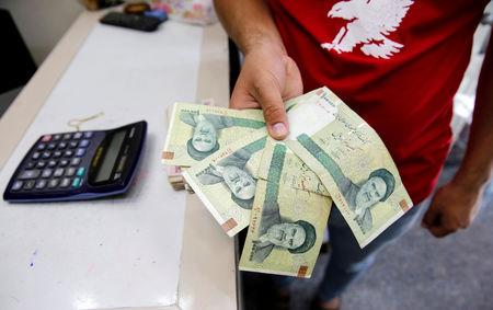 File Photo A Vendor Inspects Iranian Rials At Currency Exchange In Baghdad