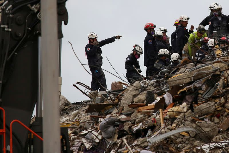 Miami firefighter breaks down as body of his seven-year-old daughter is pulled from condo rubble by his teammates before he drapes his jacket and an American flag on her and escorts her through line of rescuers