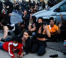 George Floyd: Fury as dozens of Minneapolis protesters nearly mowed down by truck 'arrested without being read their rights'
