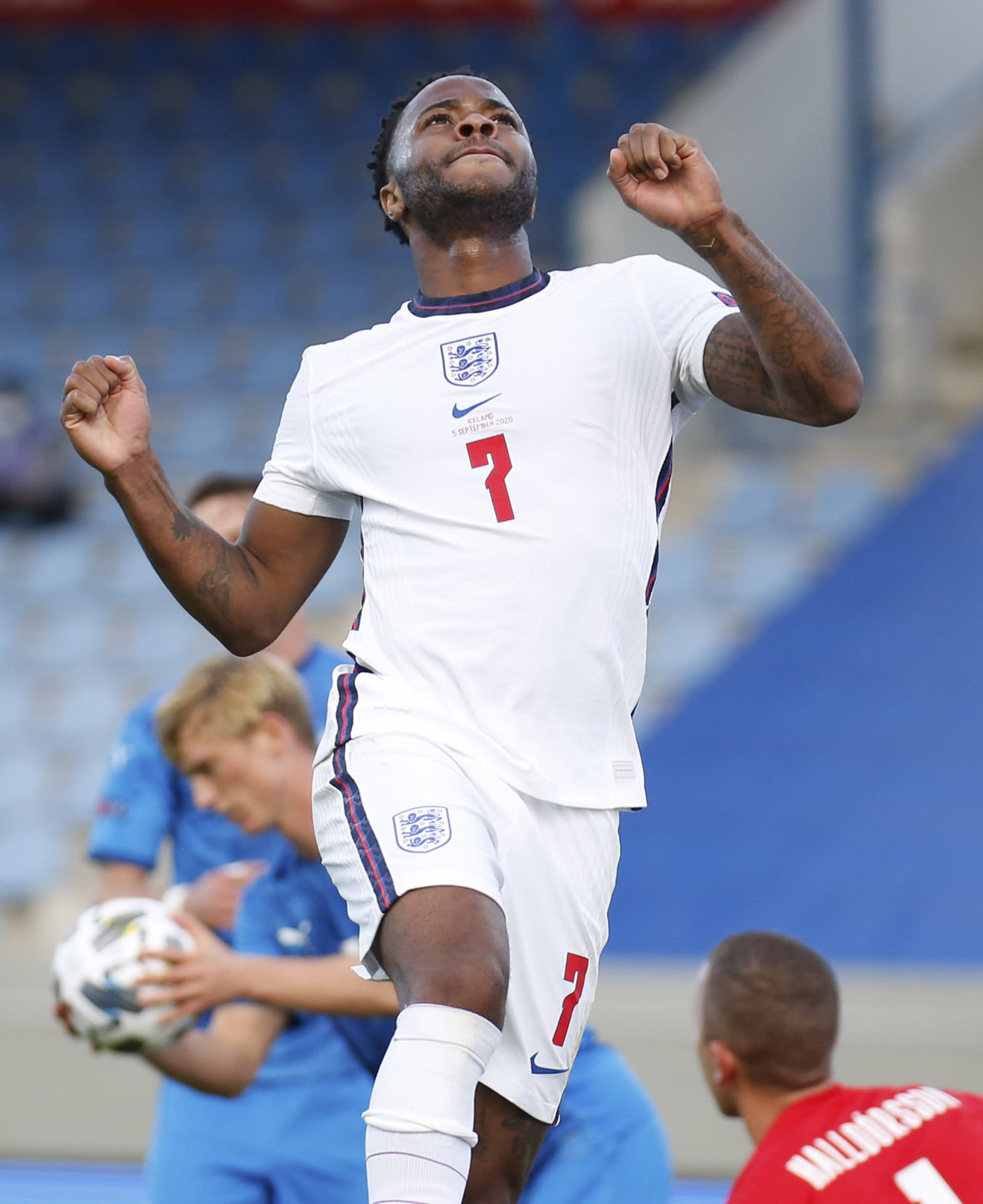 England's Raheem Sterling celebrates after scoring the opening goal from the penalty spot during the UEFA Nations League soccer match between Iceland and England in Reykjavik, Iceland, Saturday, Sept. 5, 2020. (AP Photo/Brynjar Gunnarson)
