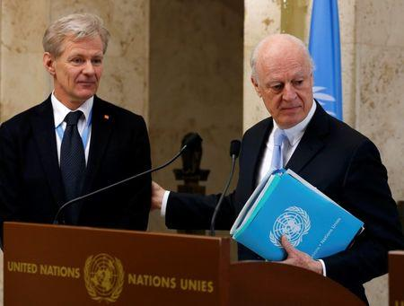 Staffan de Mistura (R), United Nations Special Envoy for Syria, arrives with his special advisor Jan Egeland to address the media after a meeting of the Task Force for Humanitarian Access at the U.N. in Geneva, Switzerland, March 3, 2016. REUTERS/Denis Balibouse