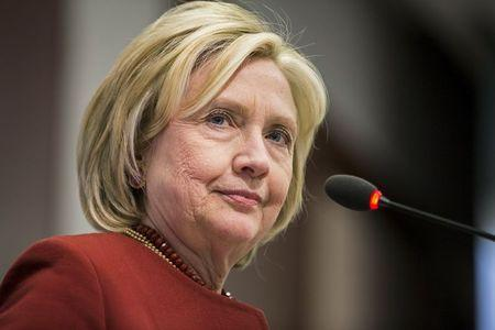 Hillary Clinton delivers remarks during the 2015 Toner Prize for Excellence in Political Reporting award in Washington
