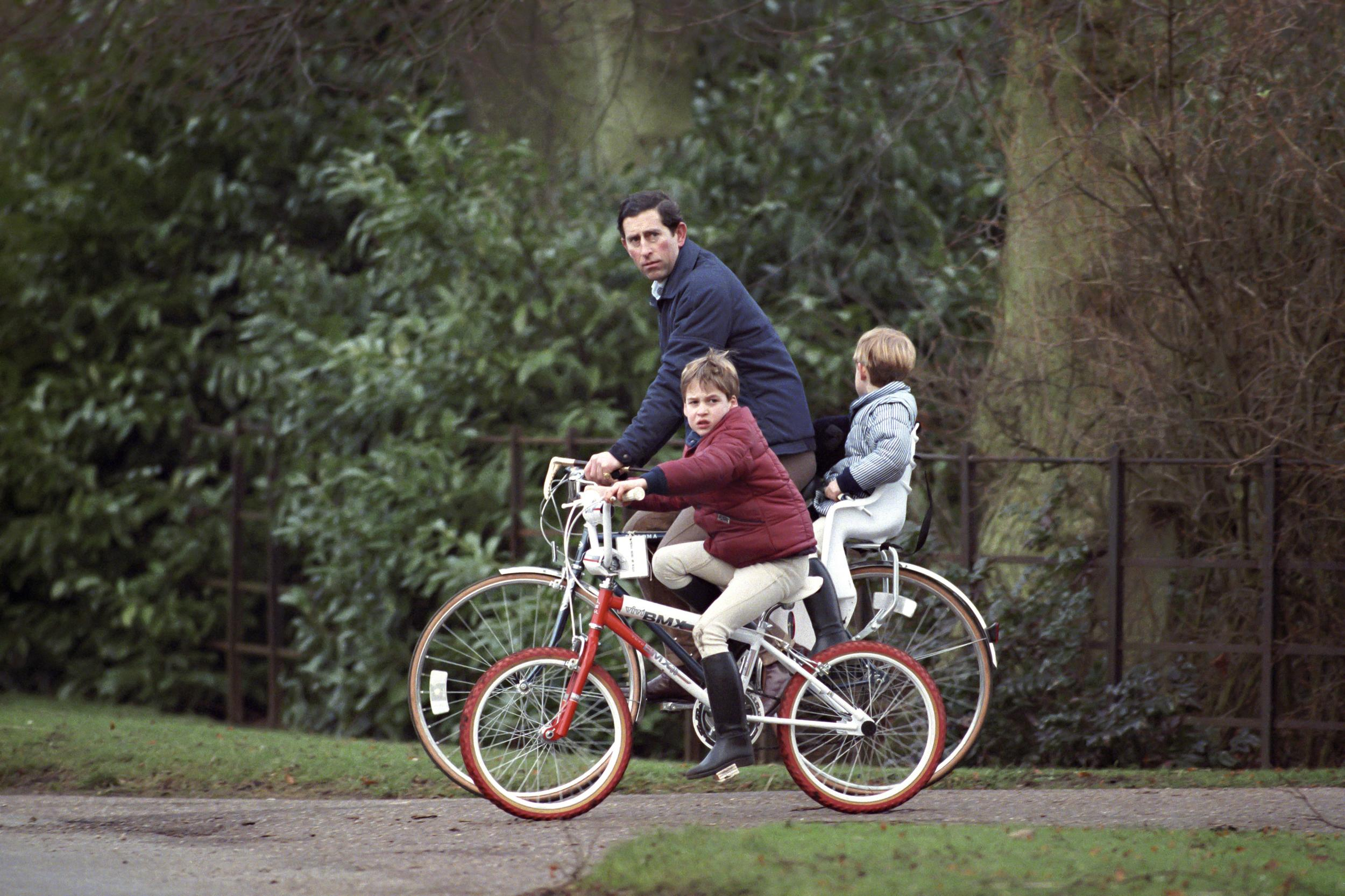 Prince Charles, Prince William And Prince Harry On Bikes Returning From The Stables, At Sandringham Estate, In Norfolk. (Photo by Julian Parker/UK Press via Getty Images)