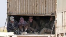 Truckloads of civilians leave Islamic State enclave in Syria