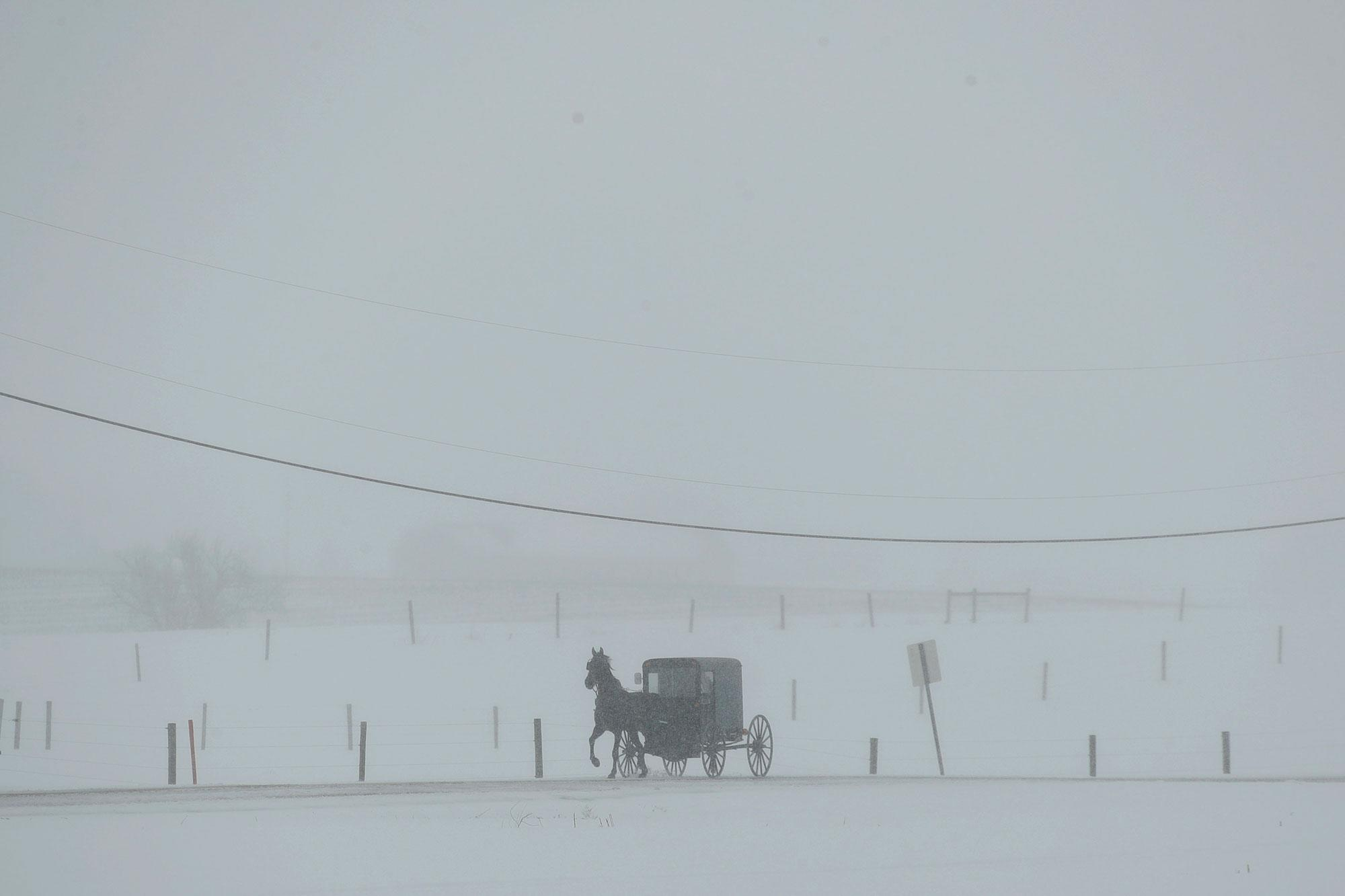<p>A horse and buggy drive through a winter snow storm, Tuesday, March 14, 2017, in Gap, Pa. (AP Photo/Matt Slocum) </p>