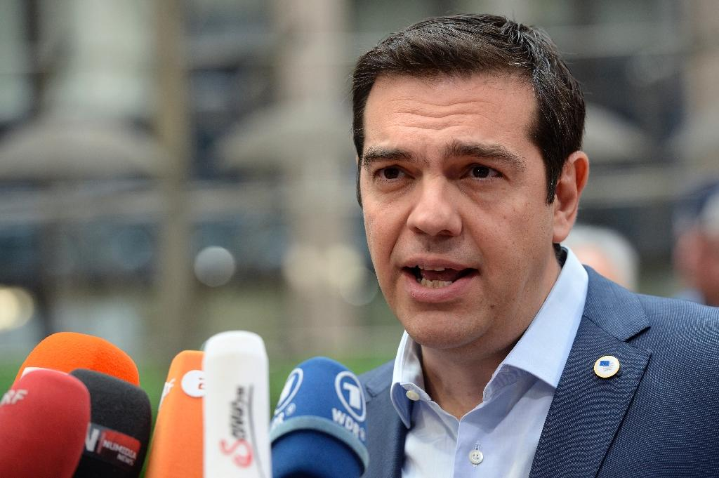 """Greece's leftist Prime Minister Alexis Tsipras (pictured in Brussels on Sunday) insisted a deal was possible on Sunday night """"if all parties want it"""", adding that he was ready for an """"honest compromise"""" (AFP Photo/Thierry Charlier)"""