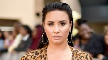 Demi Lovato says 'it hurts' that her family can't have a funeral for her grandfather due to pandemic