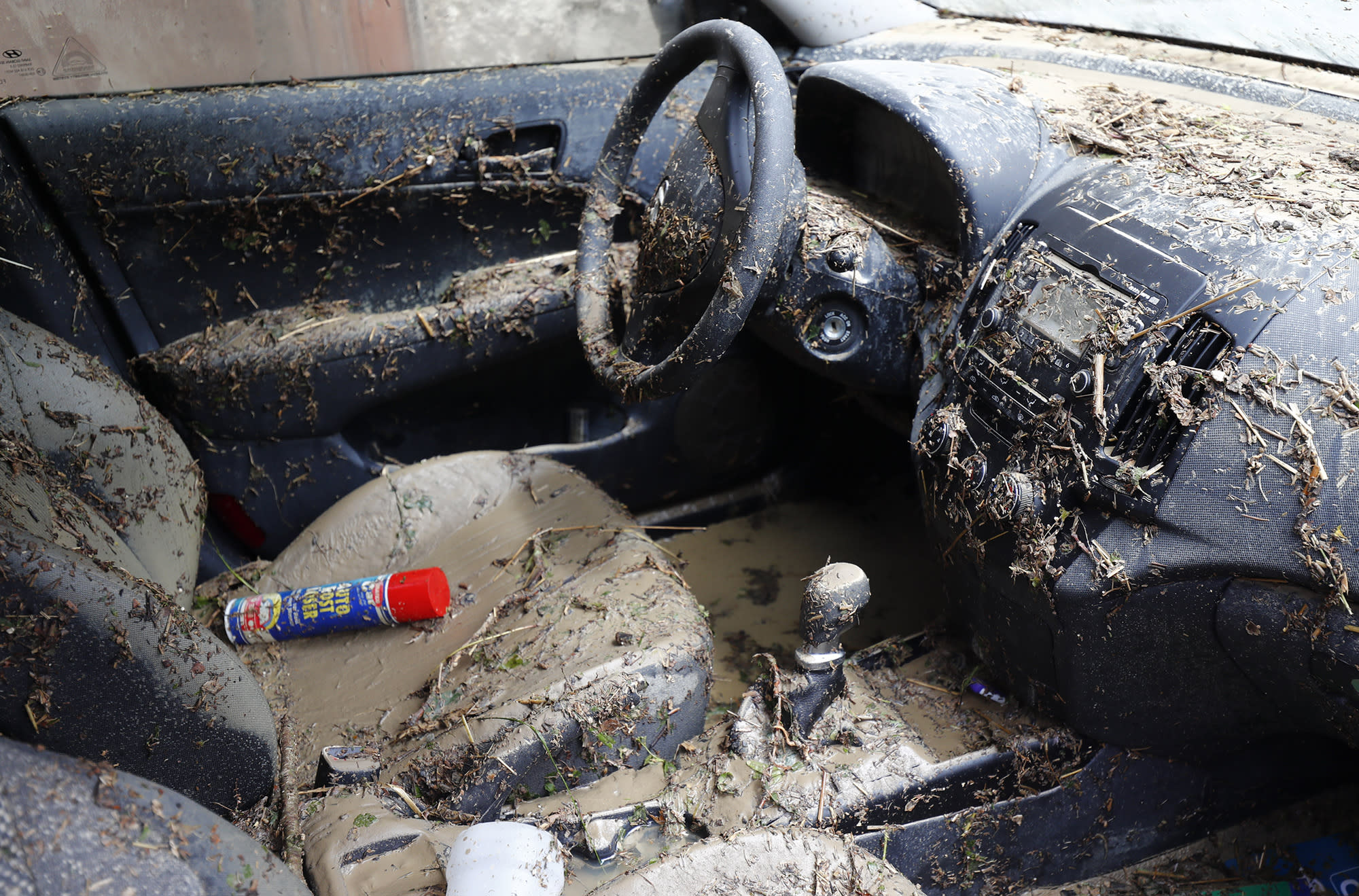 <p>The interior of a car is covered in mud from floods in Braunsbach, Germany, on May 30, 2016. (Kai Pfaffenbach/Reuters) </p>