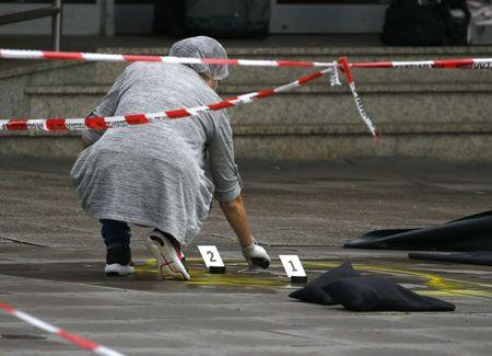 A police investigator works at the crime scene after a knife attack in a supermarket in Hamburg, Germany, July 28, 2017. REUTERS/Morris Mac Matzen