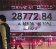 Asian shares mostly lower, China gains on GDP rebound