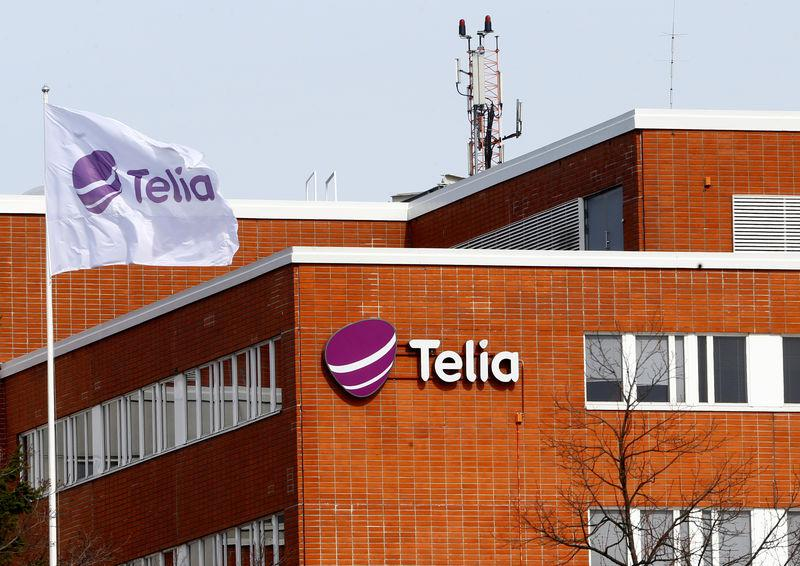 A flag flutters at the Telia offices in Helsinki