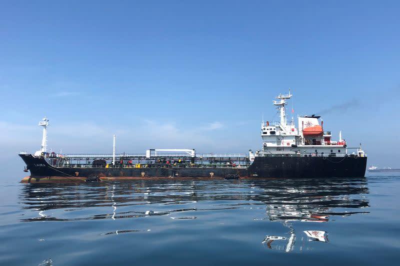FILE PHOTO: An oil tanker is seen in the sea outside the Puerto La Cruz oil refinery in Puerto La Cruz