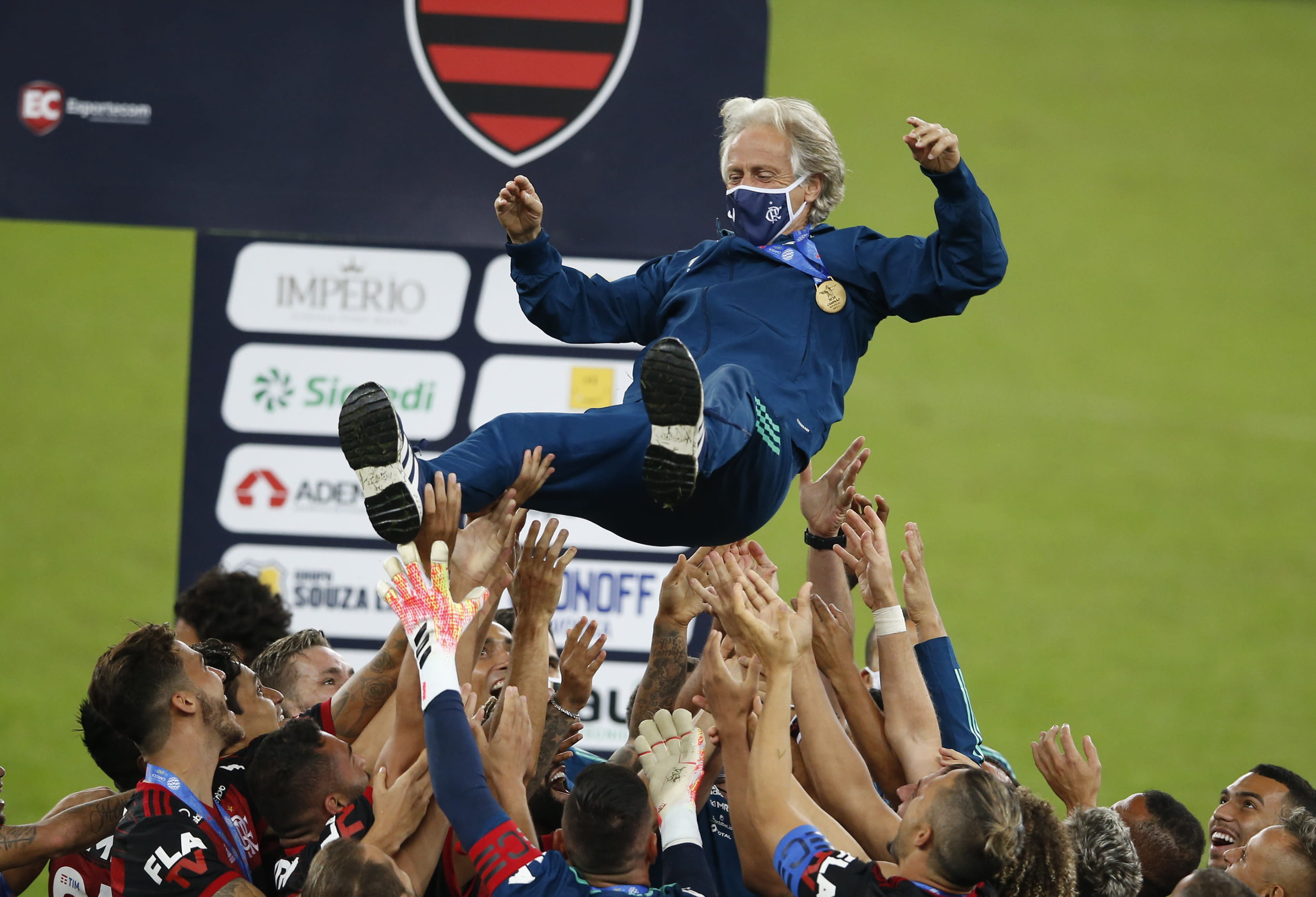 Flamengo's coach Jorge Jesus is thrown in the air by his players after winning the Rio de Janeiro state championship final soccer match at the Maracana stadium, Rio de Janeiro, Brazil, Wednesday, July 15, 2020. Flamengo won 1-0. (AP Photo/Leo Correa)