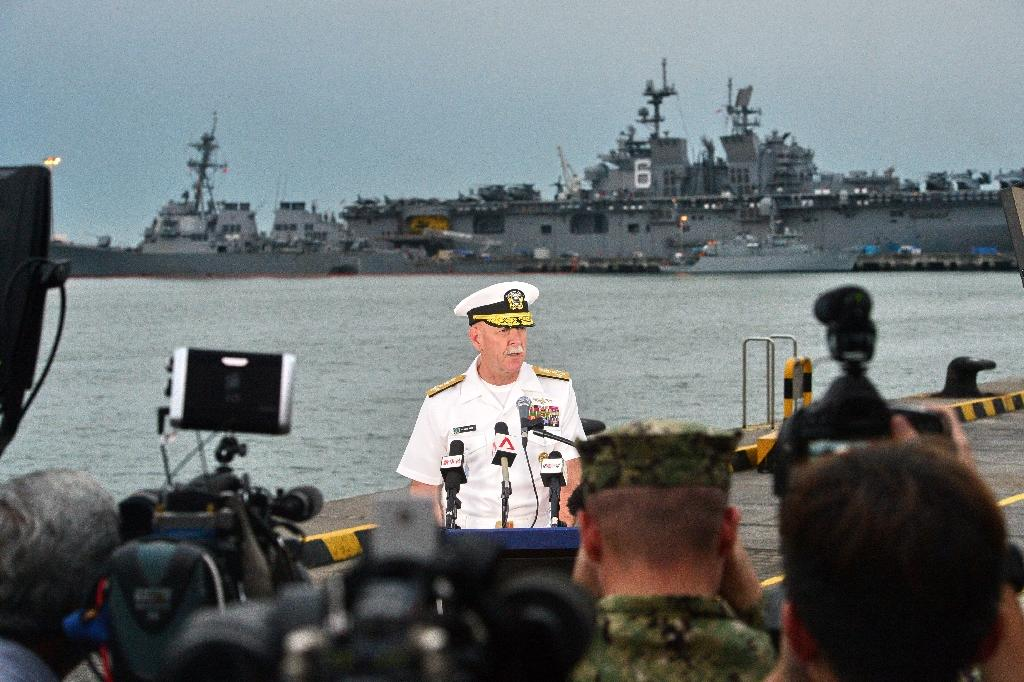Admiral Scott Swift, commander of the US Pacific Fleet, briefed the press dockside as divers searched for 10 missing sailors (AFP Photo/Roslan RAHMAN)