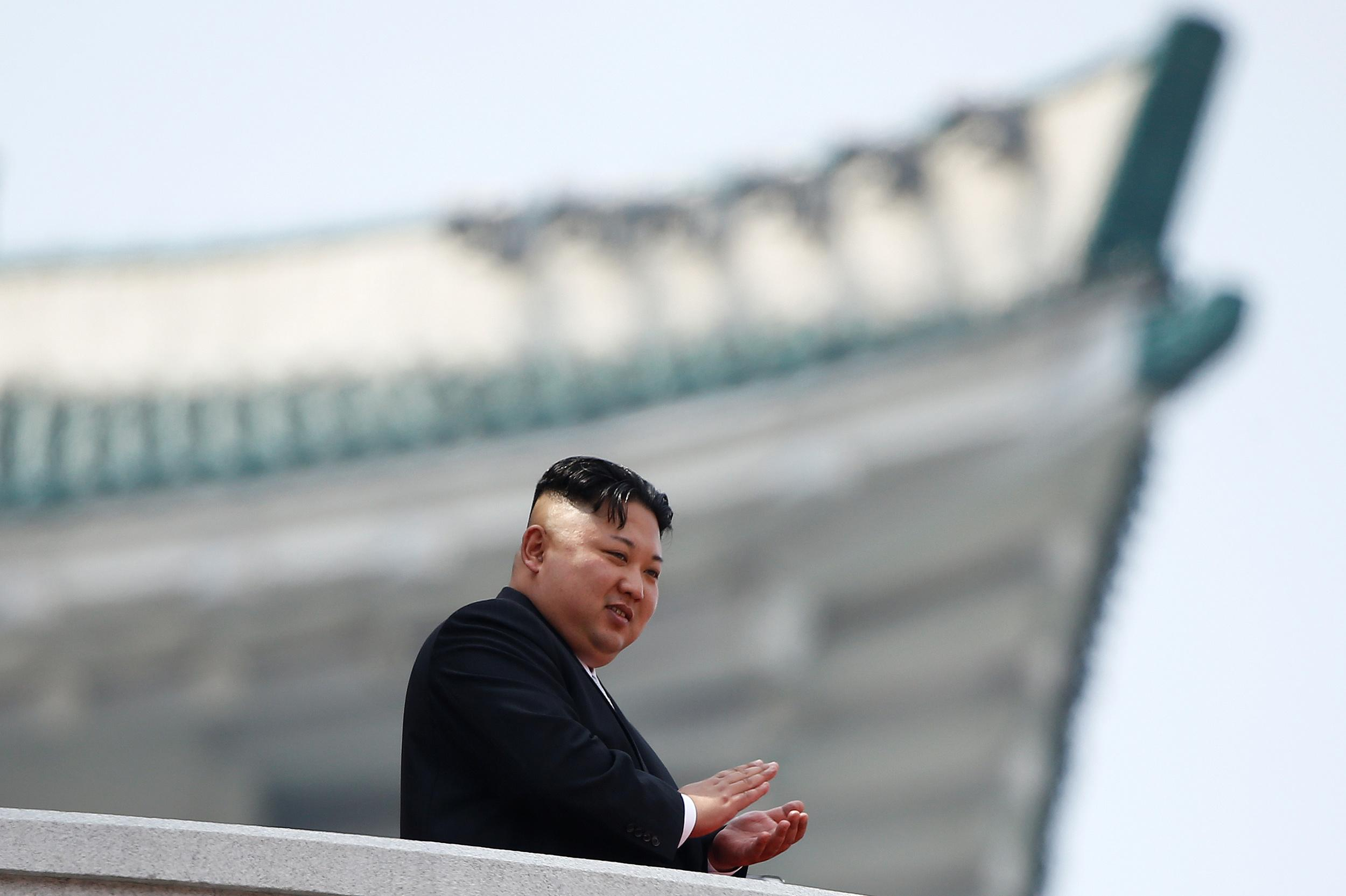 North Korean leader Kim Jong Un applauds during a military parade marking the 105th birth anniversary of the country's founding father, Kim Il Sung, in Pyongyang April 15, 2017. REUTERS/Damir Sagolj
