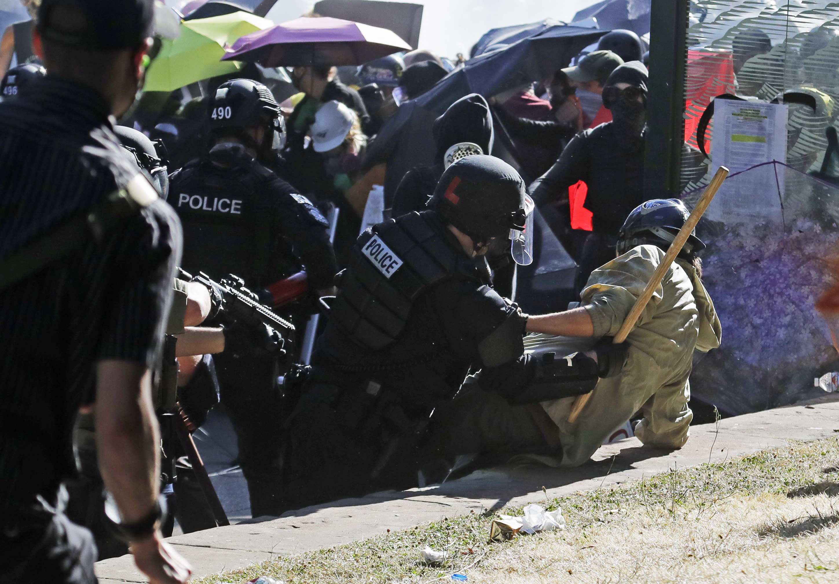 Police take down a protester, Saturday, July 25, 2020, near Seattle Central Community College in Seattle. A large group of protesters were marching Saturday in Seattle in support of Black Lives Matter and against police brutality and racial injustice. (AP Photo/Ted S. Warren)