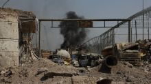 ISIS, driven out of Mosul, leaves behind a city in ruins and a society shattered by distrust