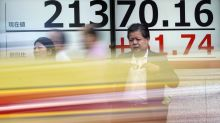 Global shares mixed as investors look to rate decisions