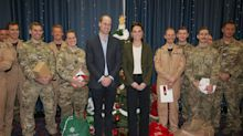 Duke and Duchess of Cambridge hand out gifts to troops away from home at Christmas