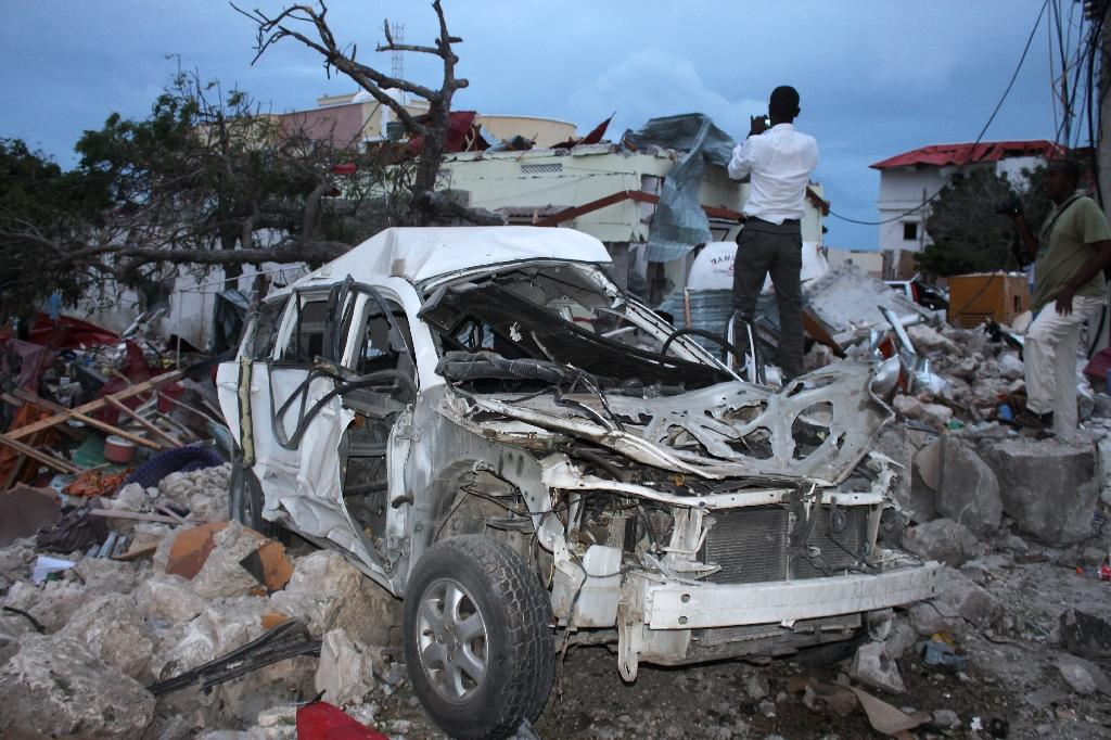 A man stands on rubble next to the damaged Jazeera Palace hotel following a suicide attack in Mogadishu on July 26, 2015 (AFP Photo/)