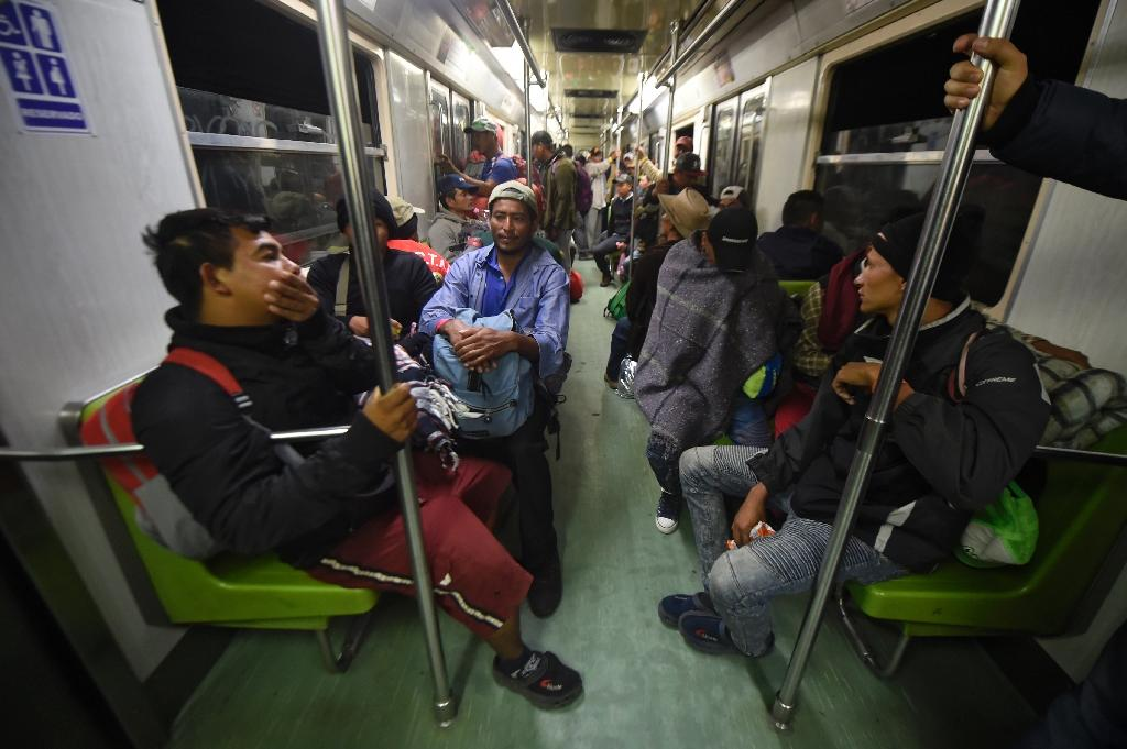 A group of Central American migrants is seen on the metro in Mexico City, on their way to Queretaro state (AFP Photo/Alfredo ESTRELLA)