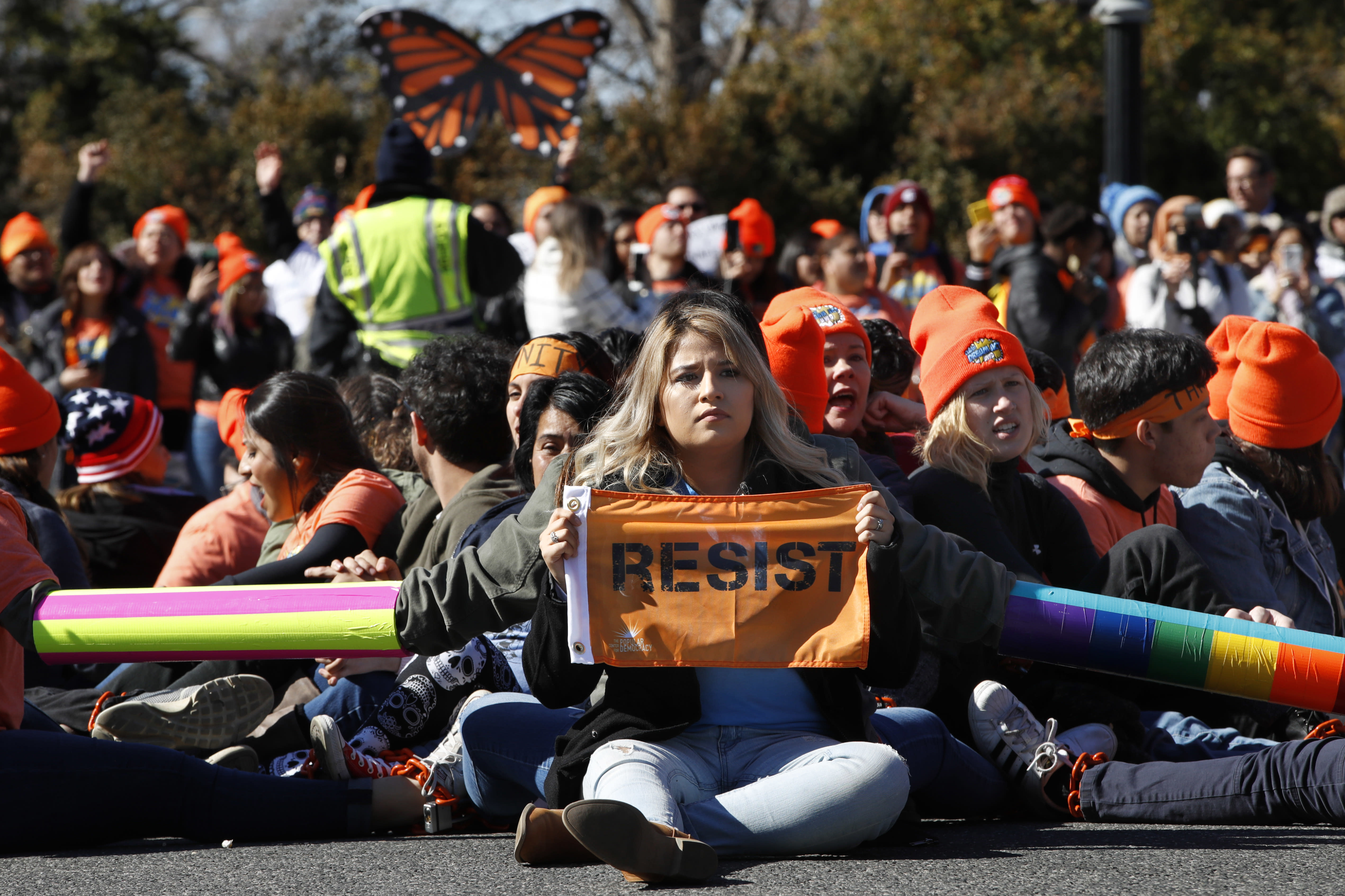 """<p>A woman holds up a sign that says, """"resist,"""" as supporters of the Deferred Action for Childhood Arrivals (DACA) block an intersection near the U.S. Capitol as an act of civil disobedience in support of DACA recipients, Monday, March 5, 2018, on Capitol Hill in Washington. (Photo: Jacquelyn Martin/AP) </p>"""