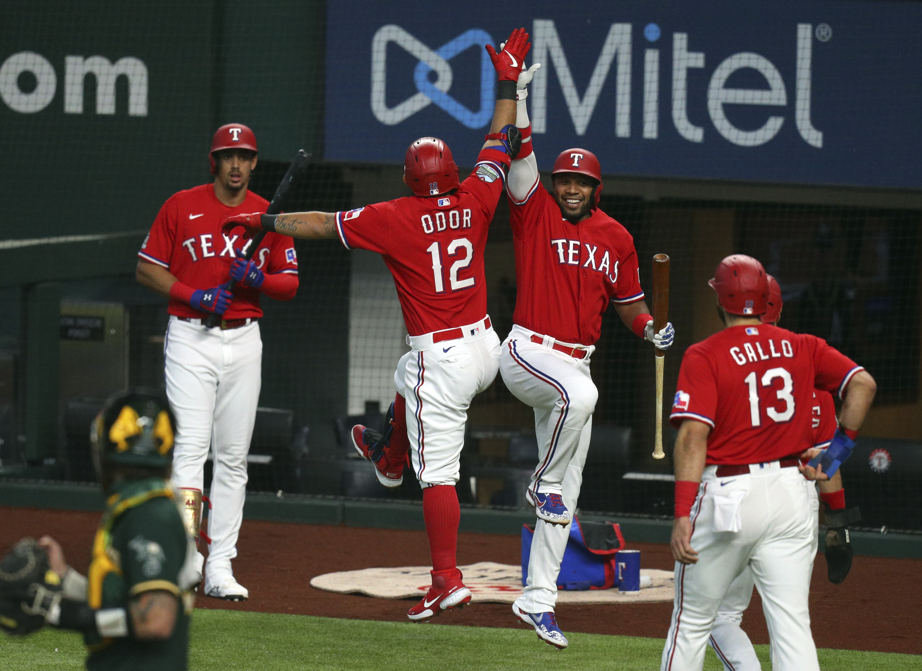Texas Rangers Rougned Odor (12) celebrates with Elvis Andrus (1)after a three-run home run in the first inning against the Oakland Athletics in a baseball game Saturday, Sept. 12, 2020 in Arlington, Texas. (AP Photo/Richard W. Rodriguez)
