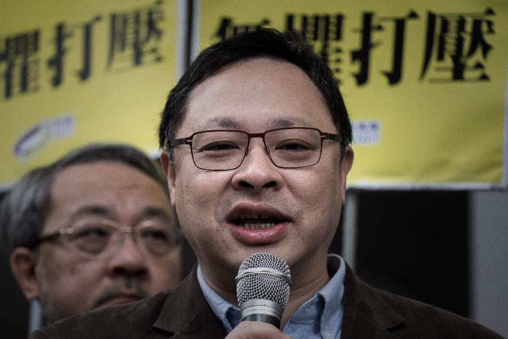 Occupy Central leader Benny Tai talks to the media outside the Wanchai police station in Hong Kong, on March 2, 2015 (AFP Photo/Philippe Lopez)