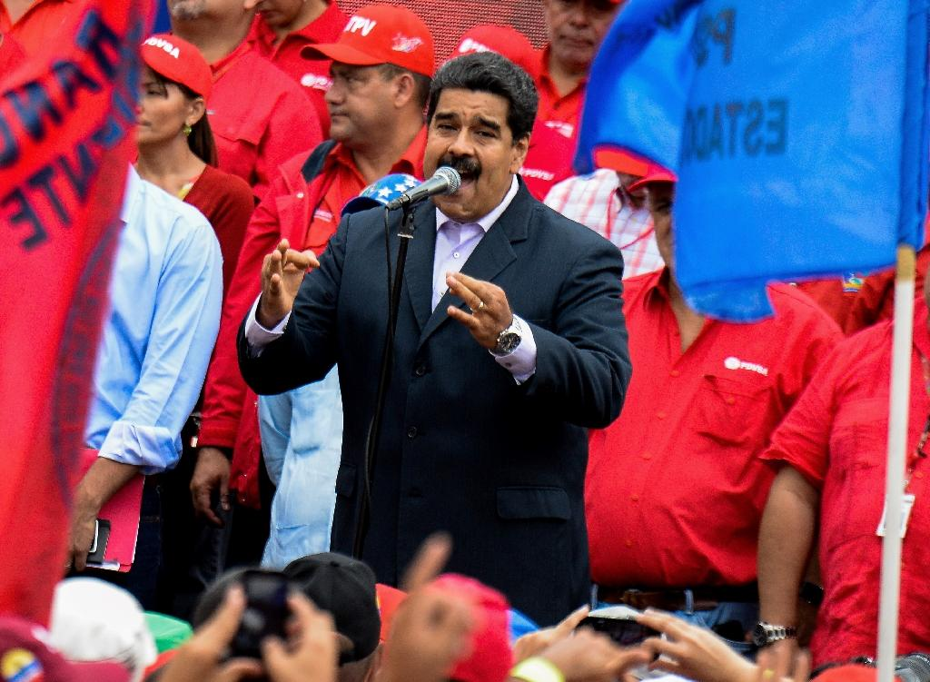 Venezuelan President Nicolas Maduro delivers a speech during a rally outside Miraflores presidential palace in Caracas on June 22, 2016