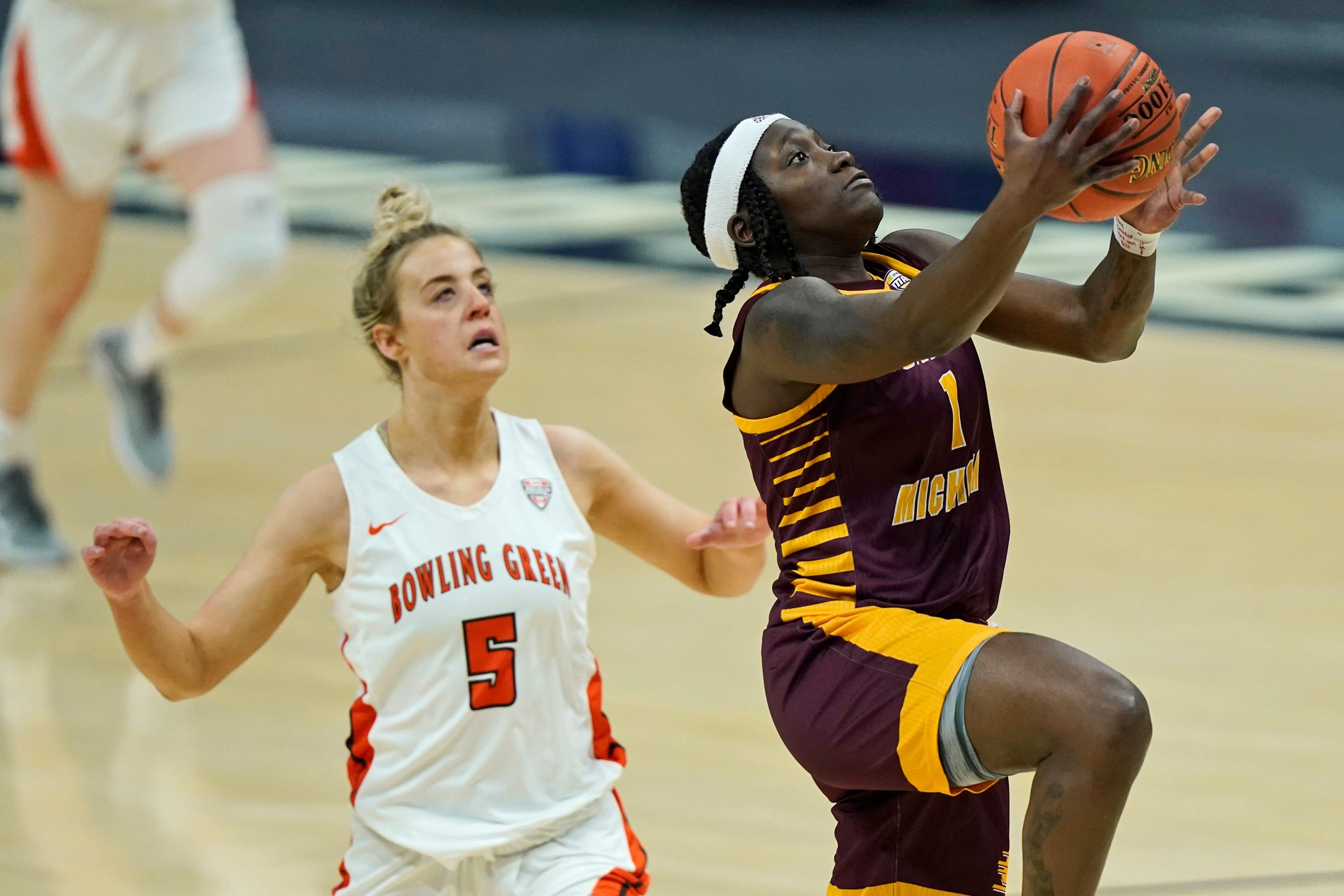 Central Michigan's Micaela Kelly drives to the basket against Bowling Green's Elissa Brett during the first half of CMU's 77-72 win in the MAC tournament final on Saturday, March 13, 2021, in Cleveland.