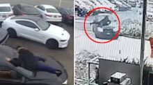 Shock video shows man clinging to BMW as it's being stolen