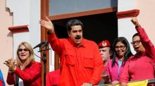 The Latest: Portugal: Maduro can't ignore people's will