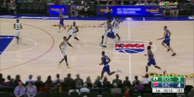 Richaun Holmes dunks on Marcus SMart in the first quarter