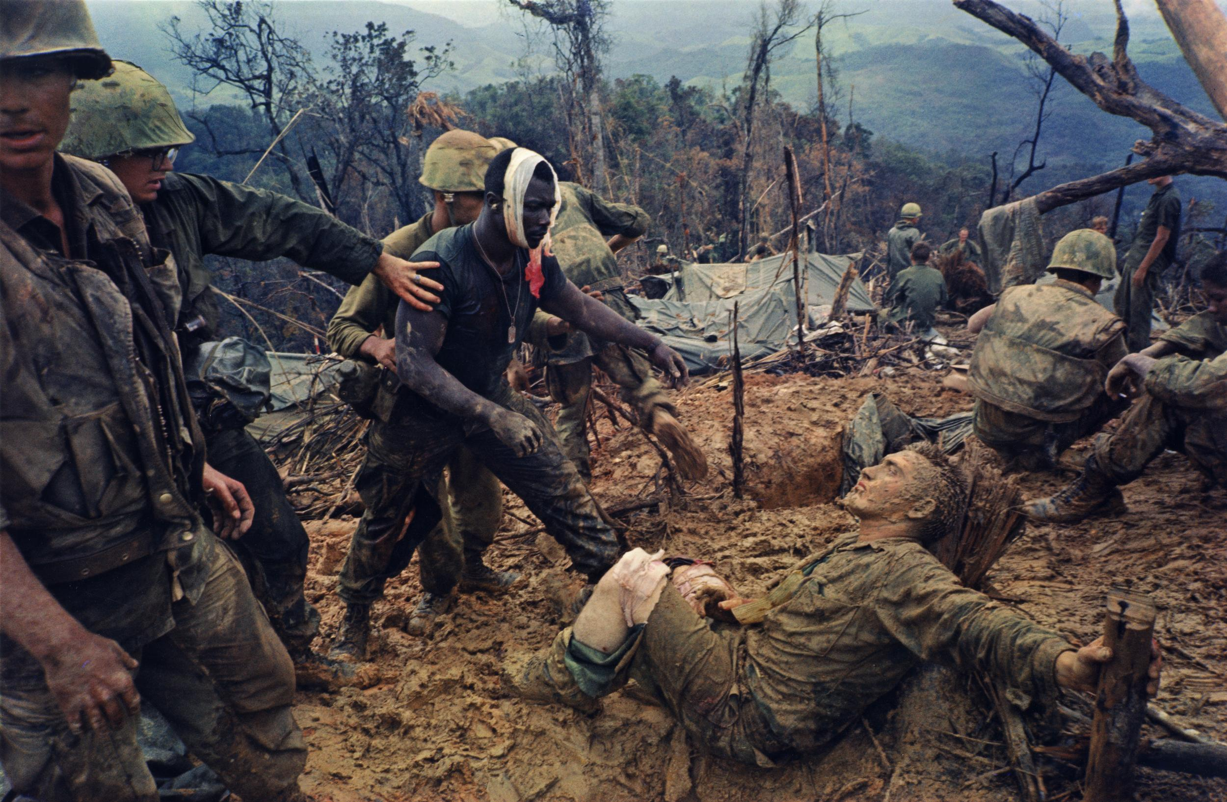 "<p>""Reaching out,"" Mutter Ridge, Nui Cay Tri, Operation Prairie, Oct. 5, 1966. (Photograph by Larry Burrows) </p>"