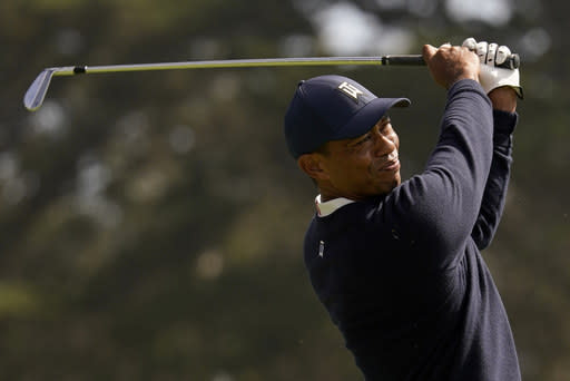 Tiger Woods watches his tee shot on the eighth hole during the second round of the PGA Championship golf tournament at TPC Harding Park Friday, Aug. 7, 2020, in San Francisco. (AP Photo/Jeff Chiu)