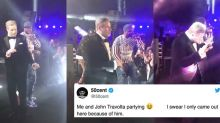 There's footage of John Travolta dancing with 50 Cent and it's priceless