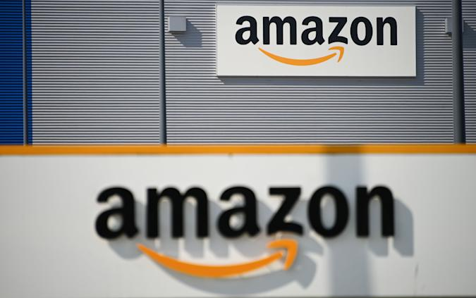 A picture shows the Amazon logo at the entrance area of the Amazon logistics centre in Lauwin-Planque, northern France, on April 16, 2020. - Amazon France said on April 16, 2020, it did not know when it would reopen its distribution centres, shuttered after a court ordered it to limit deliveries to essential goods pending a review of anti-coronavirus safety measures for its staff. (Photo by DENIS CHARLET / AFP) (Photo by DENIS CHARLET/AFP via Getty Images)