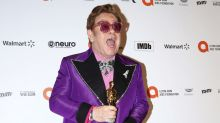 Elton John gets police escort, takes song requests at his annual Oscars charity gala