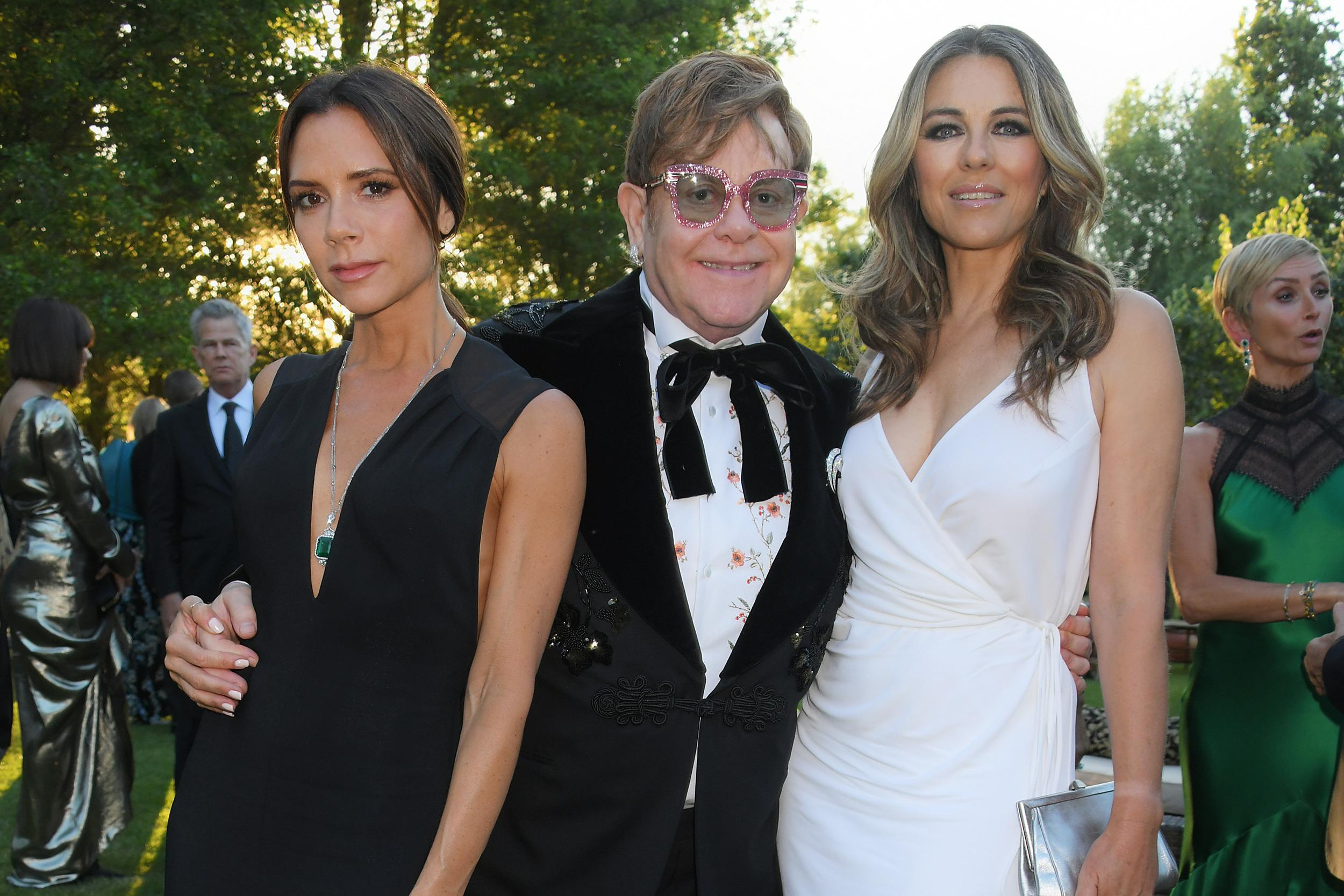 WINDSOR, ENGLAND - JUNE 27:  (L to R) Victoria Beckham, Sir Elton John and Elizabeth Hurley attend the Argento Ball for the Elton John AIDS Foundation in association with BVLGARI & Bob and Tamar Manoukian on June 27, 2018 in Windsor, England.  (Photo by David M. Benett/Dave Benett/Getty Images for BVLGARI and EJAF)