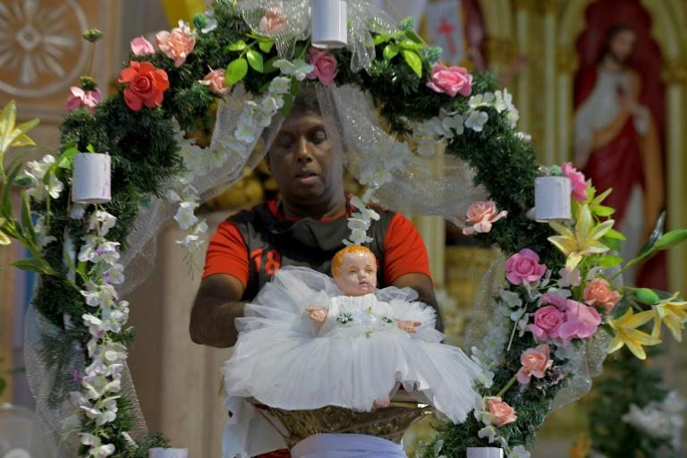 The world prepares for confined Christmas
